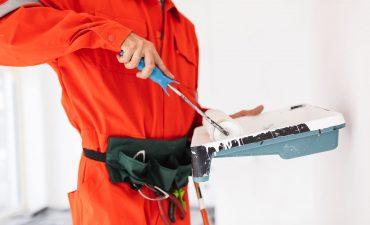 close-up-foreman-in-orange-work-clothes-using-pain-GRU5EAD.jpg